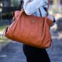Features: - Removable storage purse - Padded change mat - Shoulder strap - Stroller clips