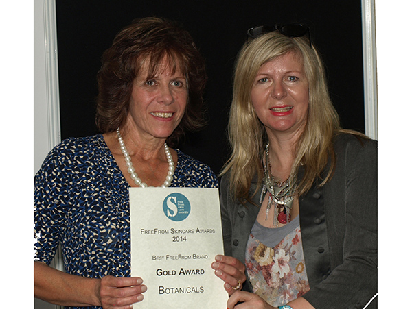 Wendy receiving award from Janey Lee Grace 2014