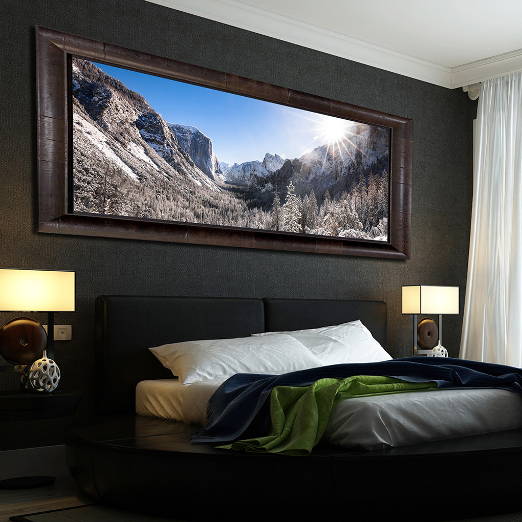 Metal print with Aspen Wood Frame hanging in rustic cabin bedroom. Landscape photography by Dan Dunn.