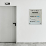 Metal Sign with standoffs, superimposed in hospital hallway. Silver gloss metal finish. Silver Oaks Hospital sign.