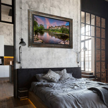 Metal print with Yosemite wood frame, superimposed in bedroom. Landscape photography of Half Dome Yosemite by Paul Brewer.