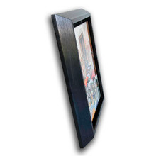 Metal print with black Bevel Frame made of brushed anodized aluminum, angled view. City photography by Louis Cantillo.