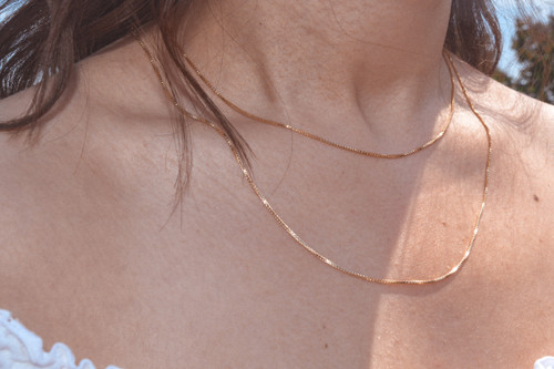 """Pictured: 16"""" and 20"""" gold filled box chain."""