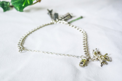 Charm bracelet and charms not included. The safety chain pictured is attached to a bracelet.