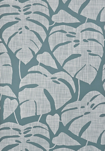 Gray-blue wallpaper with large scale tropical leaves.