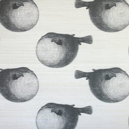 Puffer fish on grasscloth wallpaper.