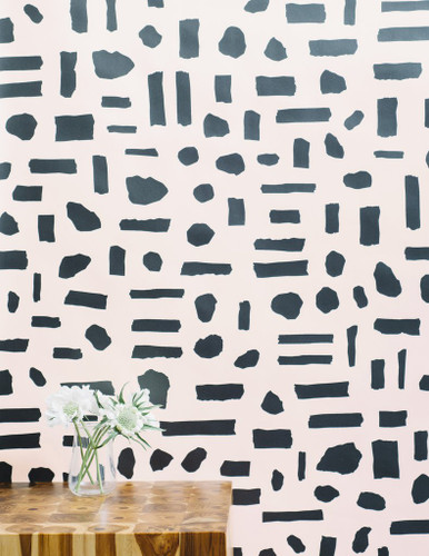 Charcoal abstract block pattern on blush wallpaper.