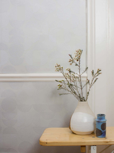 White embroidered circle and semi-circle wallpaper.