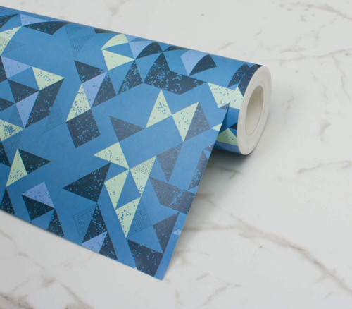 Graphic triangle patterned wallpaper in blues and green.