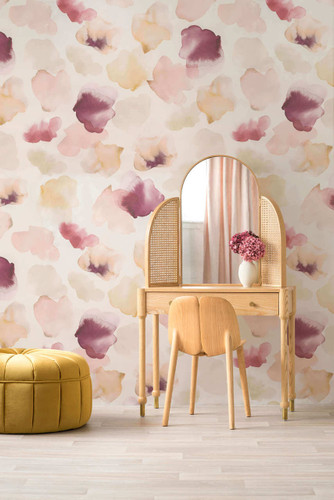Watercolored petals floating on the wall in pinks on this Emma Hayes wallpaper.