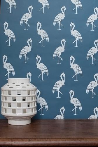 Indigo crane wallpaper with white birds.