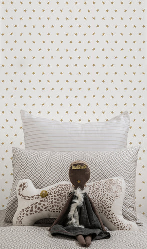 Gold stars twinkle on a white wallpaper.