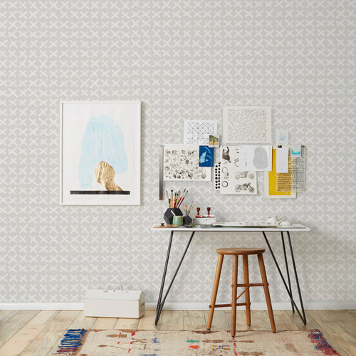 White Xs on grey wallpaper.