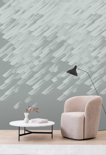 Silver brushstrokes rain down on a grey wallpaper with a pearlescent finish.