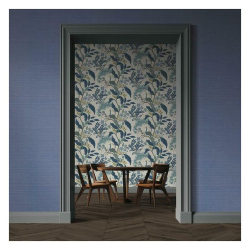 Blue grasscloth wallcovering in entry wall.