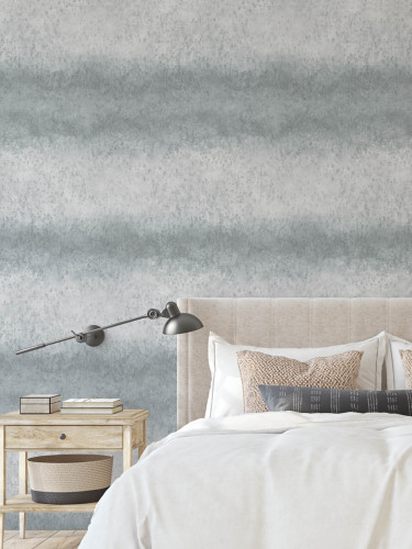 Gray wallpapered bedroom with a large scale stripe.