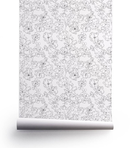 Verdant floral wallpaper in black and white.