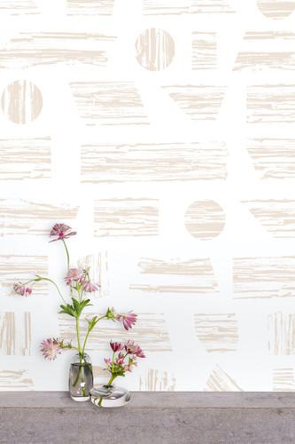 Geometric wallpaper print in taupe.