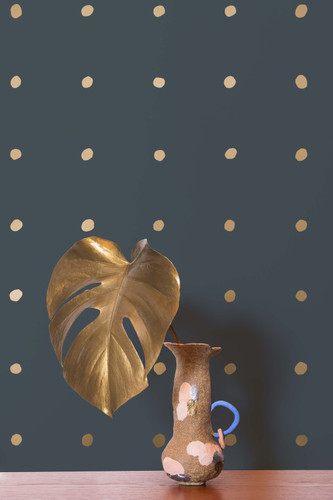 Gold metallic dots on a charcoal wallpaper.