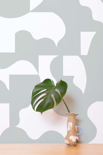 Green and white geometric wallpaper design.