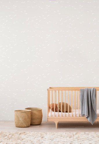 Nursery with Falling Feather wallpaper in cream.