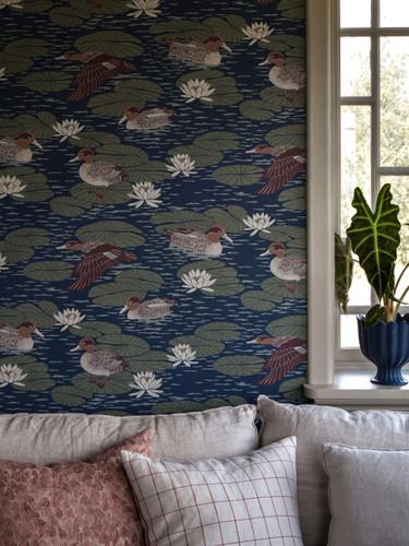 Duck wallpaper in cozy living room.