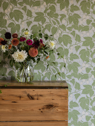 Winding stalks and beautiful leaves displayed in Hops and Glory wallpaper.