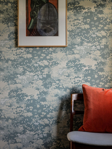 Forest inspired wallpaper in a sitting room.