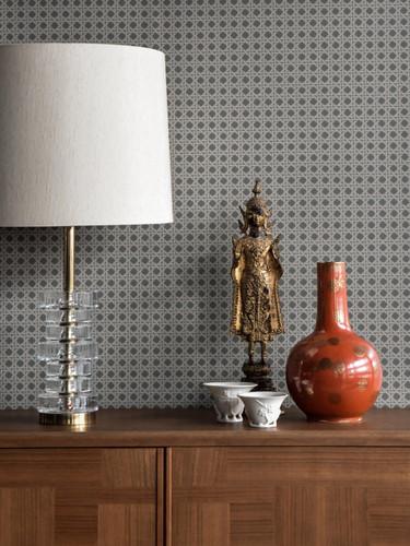 Rattan wallpaper in dark moody tones.