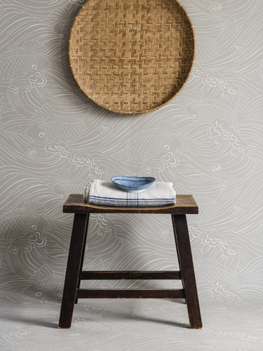 Fish and sea wallpaper in a light beige colorway.