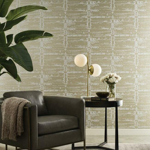 A sitting room with metallic flocked wallpaper.