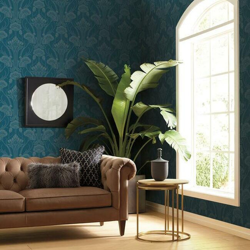 Large bloom wallpaper in a damask pattern cover the walls of a living room.