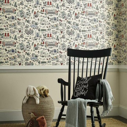 Child's room with rocking chair and storybook wallpaper.