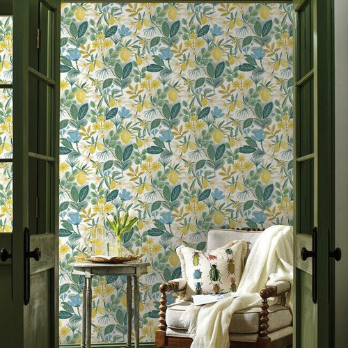 A sitting room filled with fruits and flowers on peel + stick wallpaper.