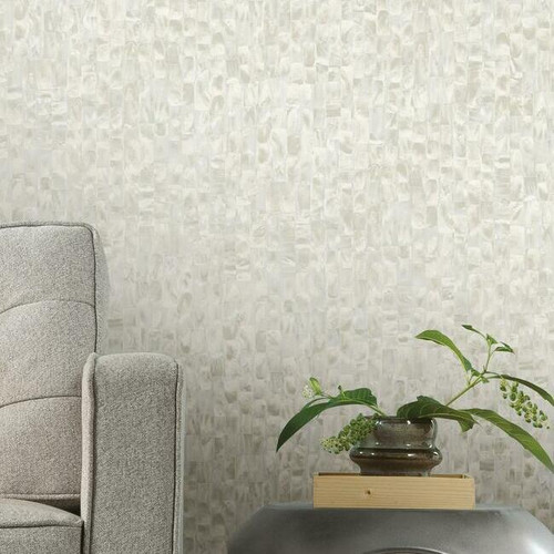 Peel + stick wallpaper with a mother of pearl iridescence.