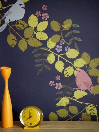 Birds and vines on a dark blue wallpaper.