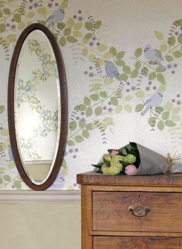 Vines and birds on a cream wallpaper with a pearl finish.