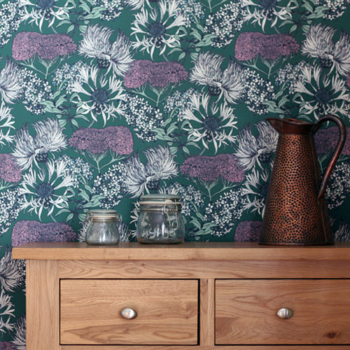 A floral medley, reminiscent of a summer flower meadow on teal wallpaper.