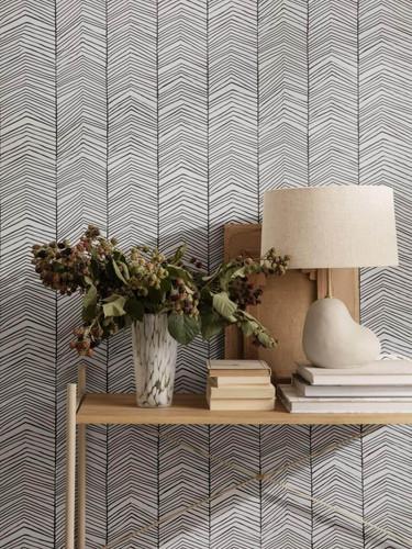 Herringbone patterned wallpaper in black + white/