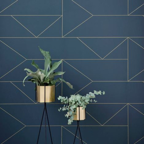 Gold geometric lines on navy wallpaper.