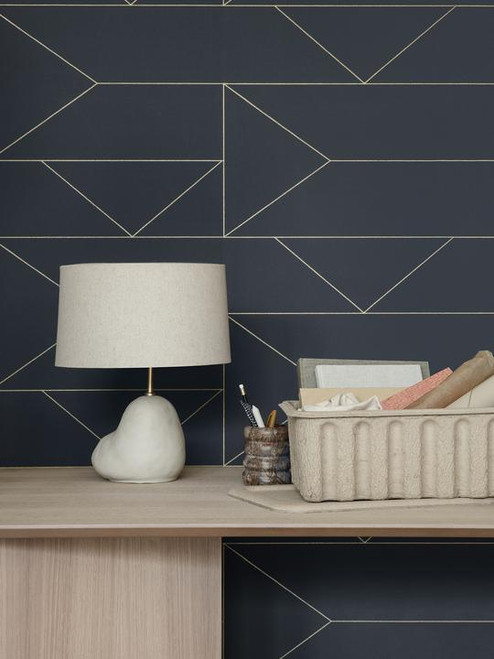 Dark gray wallpaper with gold geometric lines.