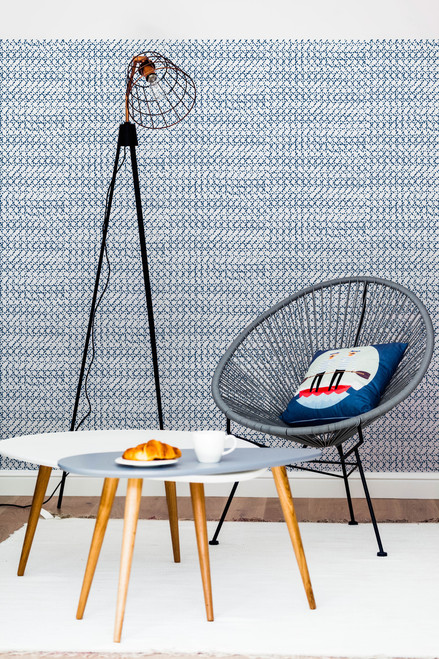 Blue rattan pattern on white wallpaper.