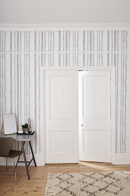 Hand-drawn wallpaper, made in England featuring drawings of Rapunzel's braids as stripes from floor to ceiling.