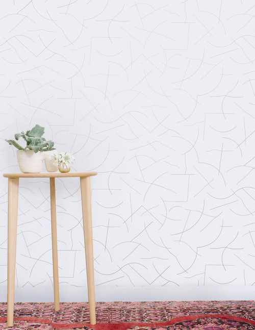Silver curvy lines on cream wallpaper.