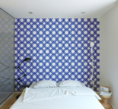 Blue circle loop wallpaper on wall in bedroom.