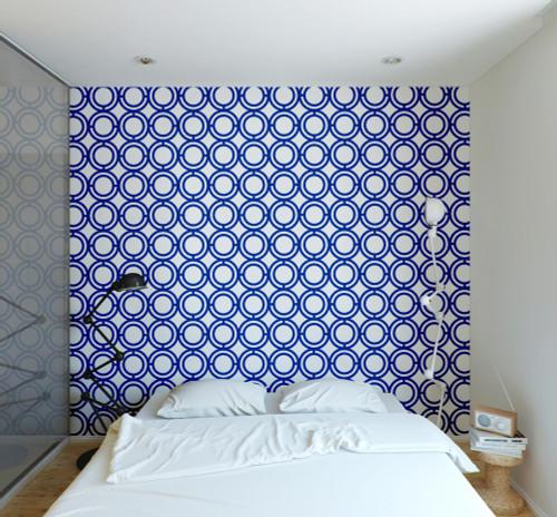 Blue circle loop wallpaper on wall in bedroom.