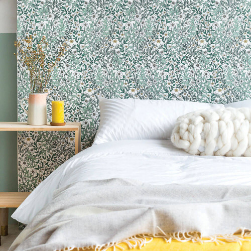 Bedroom with daisy wallpaper in moss green, white and yellow.