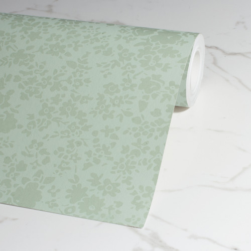 Green floral wallpaper with gloss details.