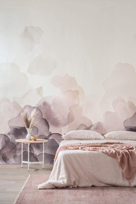 Plum-colored watercolor petals blooming on the wall in this inventive wallpaper.