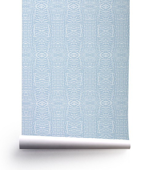 Graphic animal print patterned wallpaper roll in dove blue.